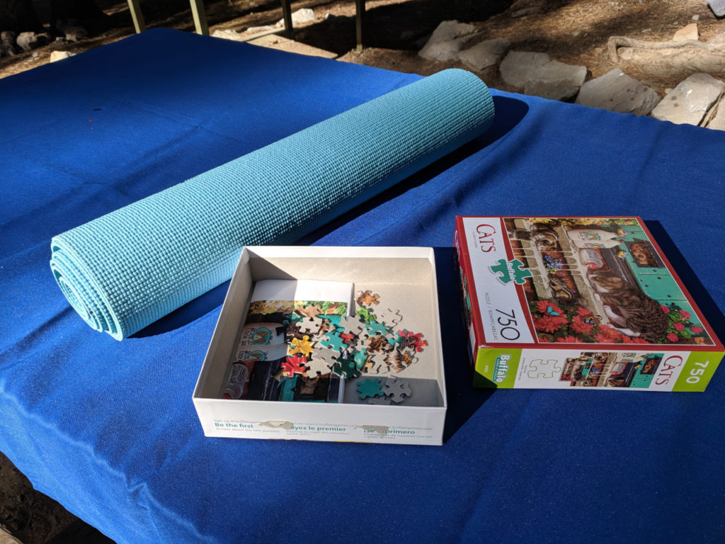 Rolled up puzzle in yoga mat for storage